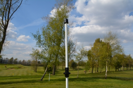 Golf flagpole spin system