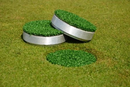 cap with grass for golf hole cup