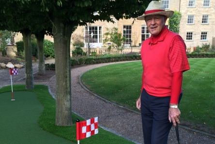 chequred golf putting green flag installation