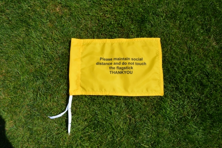 golf flags with social distance message