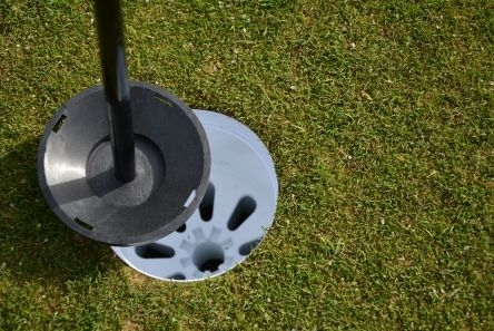 plastic ball tray in golf cup