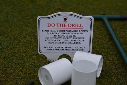practice putting set with small hole cups