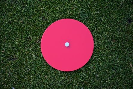 red mow over golf tee marker