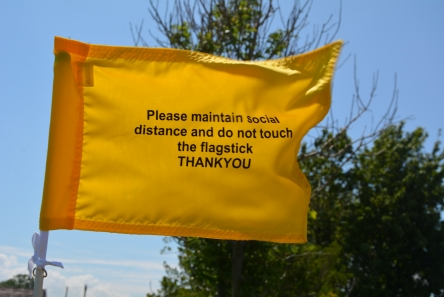 tie-on flag for golf course with social distance message
