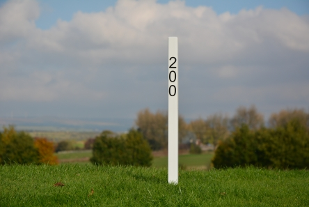 white 200 fairway distance marker post