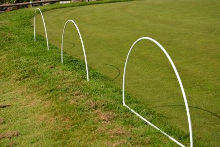 wire barrier hoop on golf course